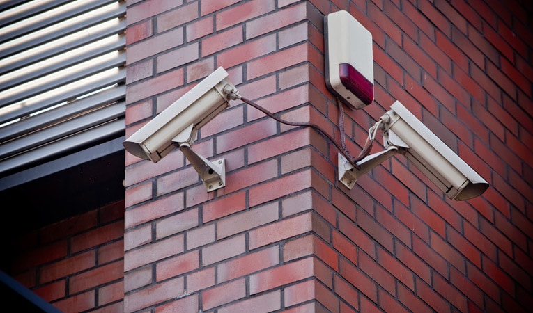 Two security cameras pointing different directions